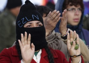 An mexican member of the Zapatista Army of National Liberation group rise hands in Khona Bahia