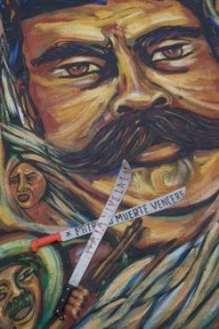 "Machetes Crossed before Photo of Emiliano Zapata: ""Fatherland or Death: We Will Conquer"" Photo: Miguel Dimayuga"