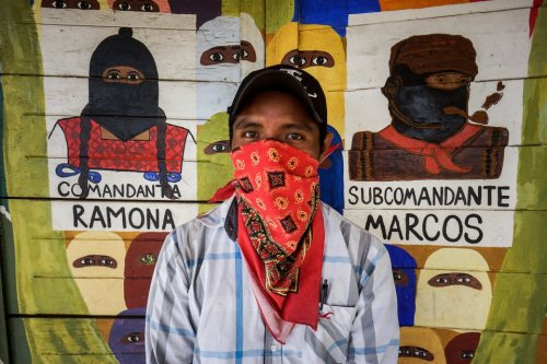 this-year-subcomandante-marcos-the-charismatic-and-mysterious-former-leader-of-the-zapatistas-and-depicted-in-the-painting-on-the-right-stepped-down-as-the-spokesman-of-the-movement-saying-i-declare-that-the-one-known-as