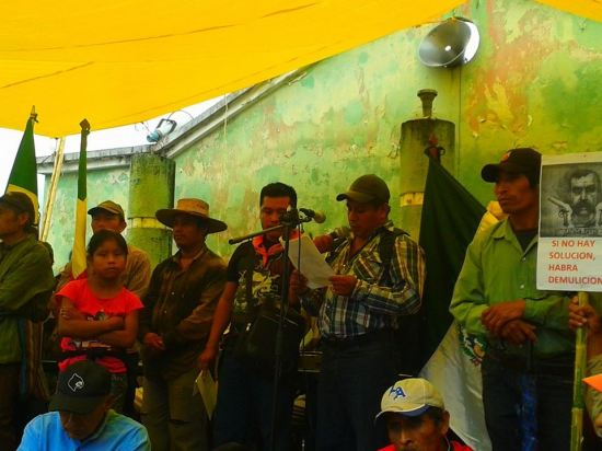 """Ejido San Sebastian Bachajón attends the 80th anniversary of the ejido Tila. """"It is the organised people who command, enough of discrimination and dispossession. No to the San Cristóbal - Palenque highway, and other megaprojects"""", they say. """"Freedom for political prisoners!"""" they demand."""