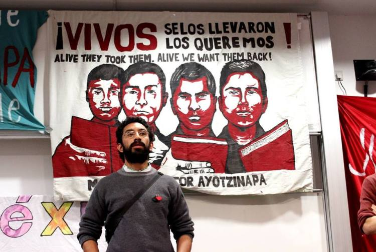 Roman Hernandez from the Guerrero-based Tlachinollan Human Rights Center speaks in front of a packed room of grassroots collectives in London.