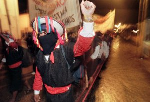 A Zapatista rebel shouts slogans during a march through San Cristobal de las Casas Monday, Sept.8, 1997, beginning a journey that will take many to Mexico City this week. Masked, but without guns, the Zapatistas are marching on the country's capital to demand support for Indian rights and their struggle in the troubled state of Chiapas. (AP Photo/Gregory Bull)