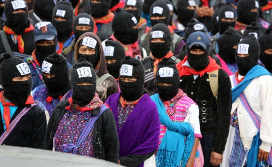 The Zapatistas marched en masse 13 Ba´ktun, or Dec. 21, 2012, marking the end of the 144,000 day Mayan long calendar and the beginning of a new era. Photo: Tim Russo/Upside Down World