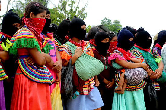 Zapatista youth and women form much of the current EZLN support base. This photo is from La Realidad during the homage to fallen Compañero Galeano – killed in a paramilitary attack in La Realidad on May 2, 2014.