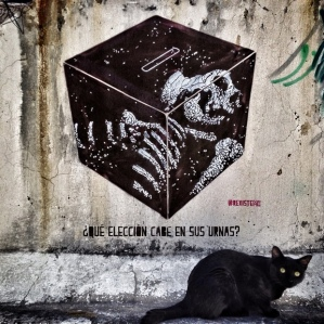 This stencil plays on the Spanish wordurna, which means both ballot box and funeral urn. According to Rexiste, 'Death is all that's represented in this country's ballot boxes.' Photograph: Rexiste