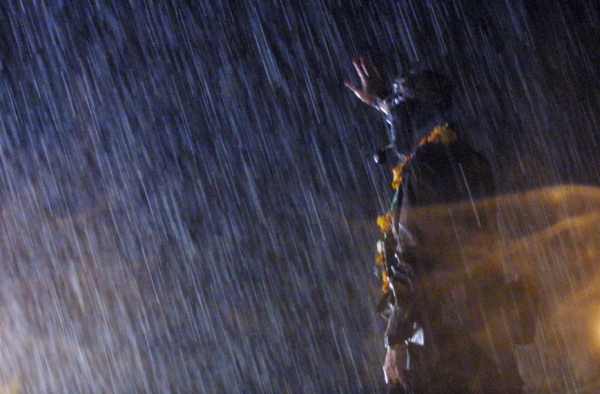 Sup Marcos speaks during a storm in Ixmiquilpan, Hidalgo during the March of the Colour of the Earth on February 28, 2001. Photo: La Jornada.