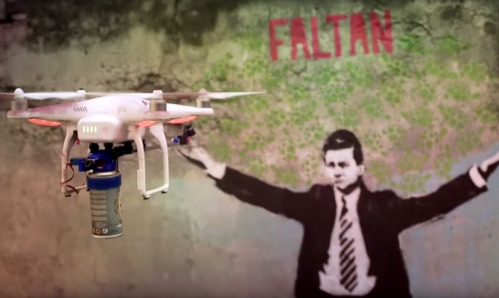Droncita, billed as Mexico's first graffiti drone, prepares to deface a picture of the country's embattled president, Enrique Peña Nieto. Photograph: Droncita Rexiste