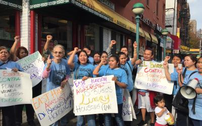 East Harlem residents rally against Mayor Bill de Blasio's plan to rezone the neighborhood for luxury housing.