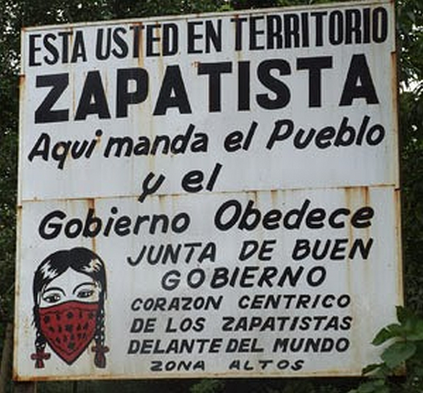 "Sign: ""You are in Zapatista Territory. Here the people lead and the good government obeys. Central Zapatista Heart of the Highlands zone"""